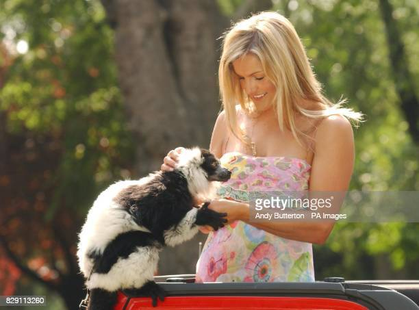 TV presenter Katy Hill with a South American Lima during a photocall to launch the Nintendo Konga Beach party at London Zoo in Regents Park central...