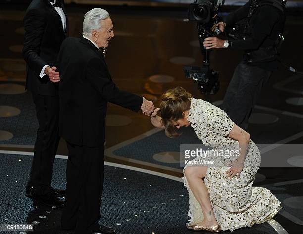 Presenter Kirk Douglas shakes hands with actress Melissa Leo after Leo won the Actress in a Supporting Role award for 'The Fighter' onstage during...