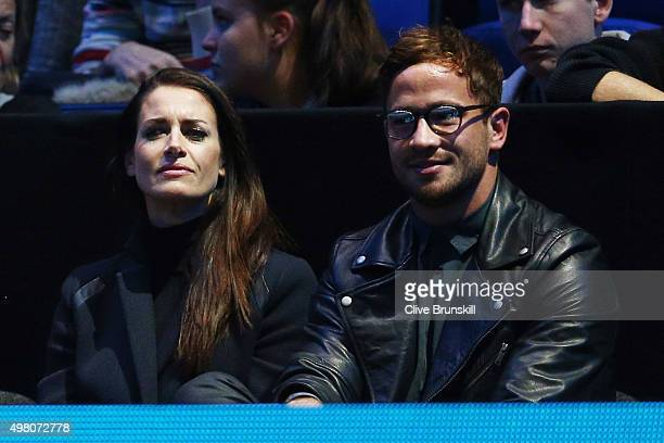 TV presenter Kirsty Gallacher and rugby union player Danny Cipriani of Sale Sharks and England watch the action during the men's singles match...