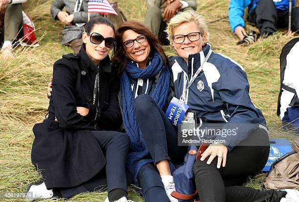 Presenter Kirsty Gallacher Suzanne Torrance wife of Europe team vice captain Sam Torrance and Pernilla Bjorn wife of Thomas Bjorn of Europe watch the...