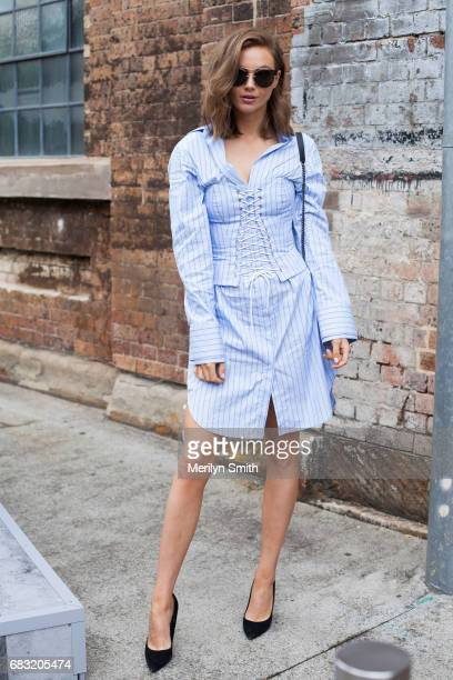 Presenter Ksenija Lukich is wearing a Strateas Carlucci dress Miu Miu shoes and a YSL bag during MercedesBenz Fashion Week Resort 18 Collections at...