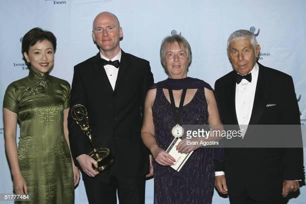 Presenter Lan Yang chairman of Sun Media Investment Holdings of China filmmaker Patrick Collerton winner of the International Emmy Award for Best...