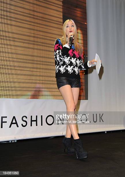 Presenter Laura Whitmore speaks on stage as she helps Tulisa Contostavlos open her very own popup store during the TFB by Tulisa for Bank launch...