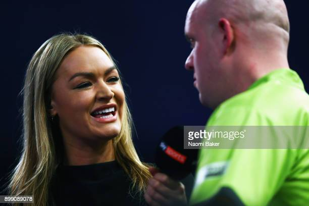 Presenter Laura Woods speaks to Michael van Gerwen of the Netherlands after he wins his third round match against Gerwyn Price of Wales on day eleven...