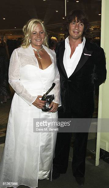 TV presenter Laurence LlewelynBowen and his wife Jackie arrive at the TV Quick Awards 2004 at The Dorchester on September 6 2004 in London The annual...
