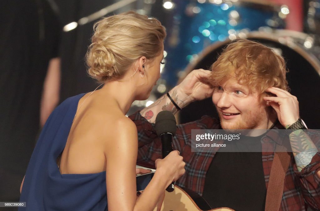 Tv Presenter Lena Gercke And Musician Ed Sheeran Stand