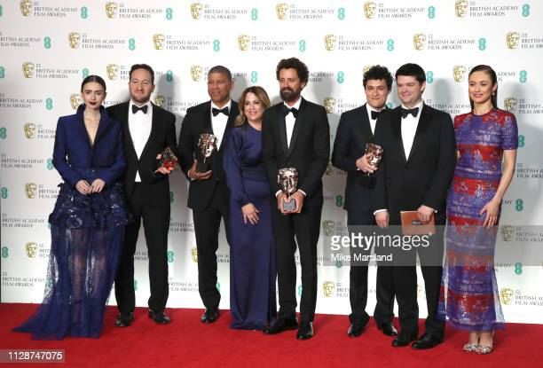 Presenter Lily Collins with winners of the Animated Film award for SpiderMan Into the SpiderVerse directors Rodney Rothman and Peter Ramsey Christina...