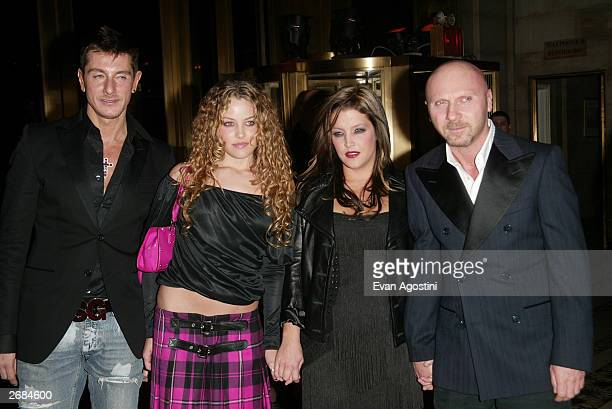 Presenter Lisa Marie Presley and daughter Riley Keough pose with designers Stefano Dolce and Domenico Gabbana at The Fashion Group International's...