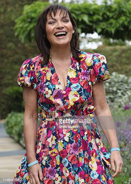 Presenter Lorraine Kelly poses for a photograph on the BQ stand during Chelsea Flower Show Press and VIP Day on May 23 2011 in London England