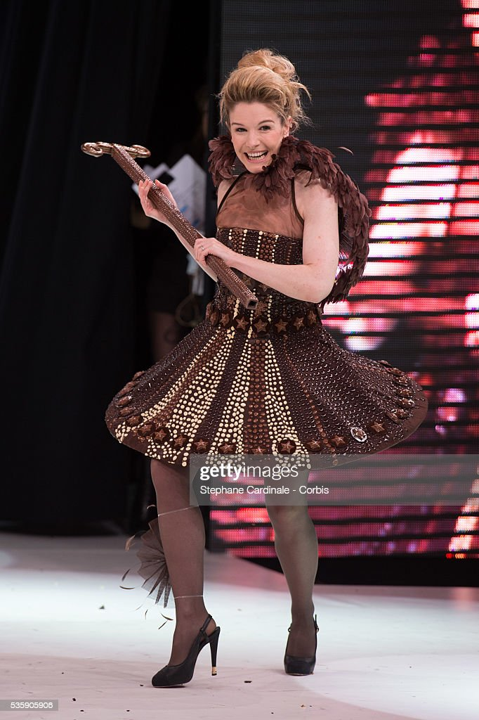 TV presenter Louise Ekland walks the runway and wear chocolate creation made by designer Nathalie Erkan and chocolate maker Franck Kestener during the Fashion Chocolate Show at Salon du Chocolat at Porte de Versailles, in Paris.