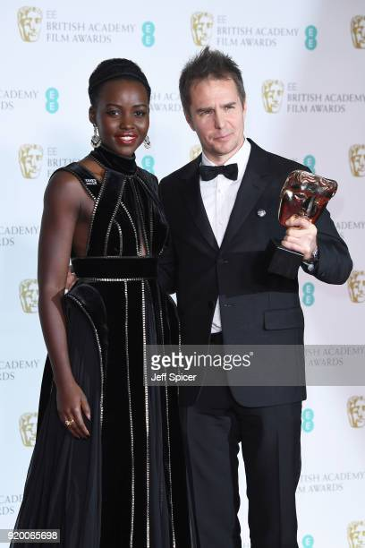Presenter Lupita Nyong'o and Sam Rockwell winner of the Best Supporting Actor award for the movie 'Three Billboards Outside Ebbing Missouri' pose in...