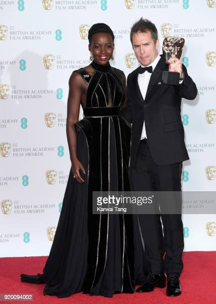 Presenter Lupita Nyong'o and winner of the Supporting Actor Award for 'Three Billboards Outside Ebbing Missouri' Sam Rockwell pose in the press room...