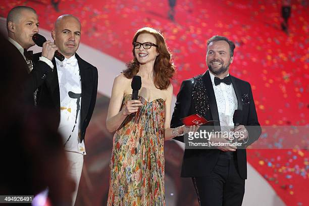 Presenter Manuel Rubey actors Billy Zane Marcia Cross and presenter Thomas Stipsits are seen on stage during the Lifeball 2014 at City Hall on May 31...