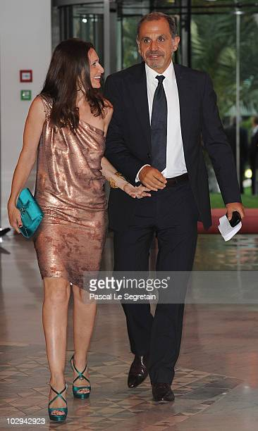 TV presenter Marc Toesca arrives with unidentified friend to attend the 2010 Annual FightAIDS Monaco Gala dinner on July 16 2010 in Monaco Monaco