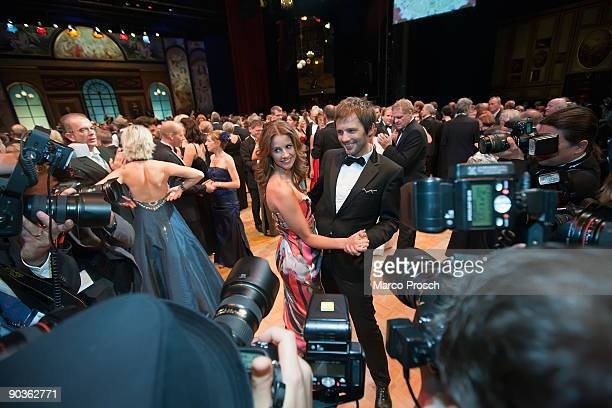 TV presenter Mareille Hoeppner and Arne Schoenfeld are surrounded by photographers at the 15th Opera Ball Leipzig on September 5 2009 in Leipzig...