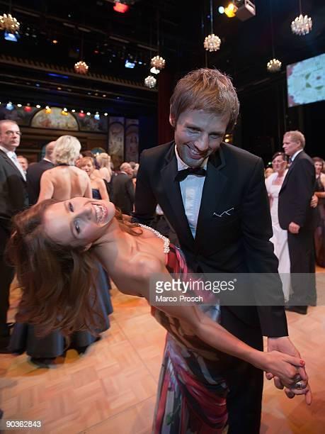 TV presenter Mareille Hoeppner and Arne Schoenfeld attend the 15th Opera Ball Leipzig on September 5 2009 in Leipzig Germany