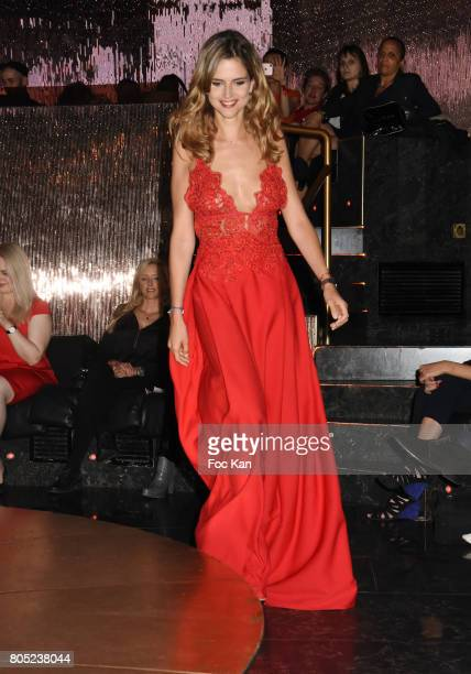 TV presenter Margaux De Frouville by Laura Laval walks the runway during the 'Red Defile' Auction Fashion Show Hosted by Ajila Association...