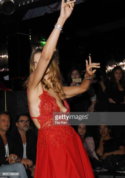 TV presenter Margaux De Frouville dressed by Laura Laval walks the runway during the 'Red Defile' Auction Fashion Show Hosted by Ajila Association...