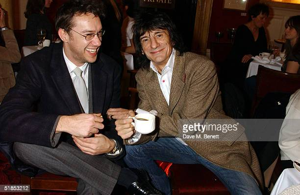 TV presenter Mark Lamarr and musician Ronnie Wood attend Wood's High Tea Private View in the Theatre Royal on Drury Lane December 12 2004 in London...