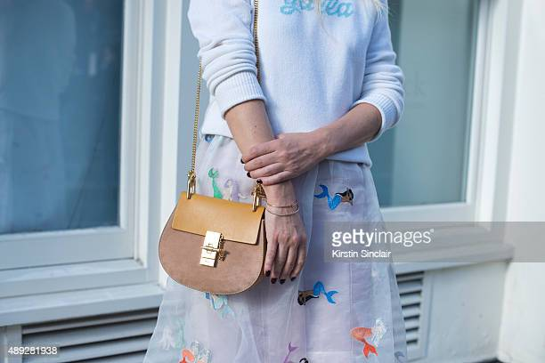 TV presenter Martha Ward wears a Alexander Lewis sweater and skirt Chloe bag on day 2 during London Fashion Week Spring/Summer 2016/17 on September...