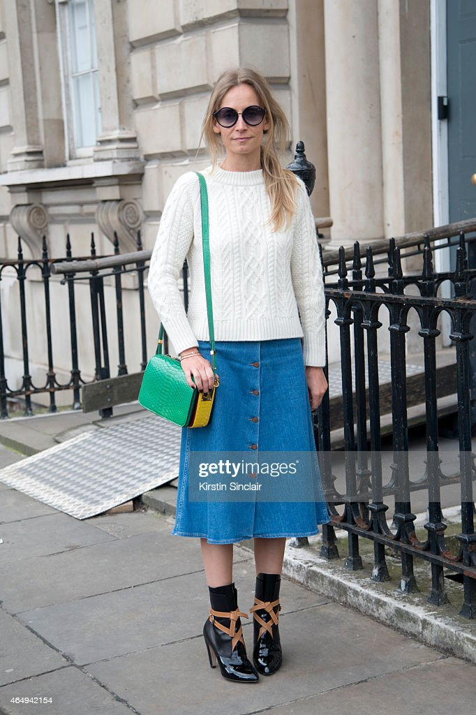 TV presenter Martha Ward wears Luis Vuitton boots, a MiH skirt, Sophie Hulme bag, A.P.C sunglasses, Iris and Ink sweater on February 24, 2015 in London, England.