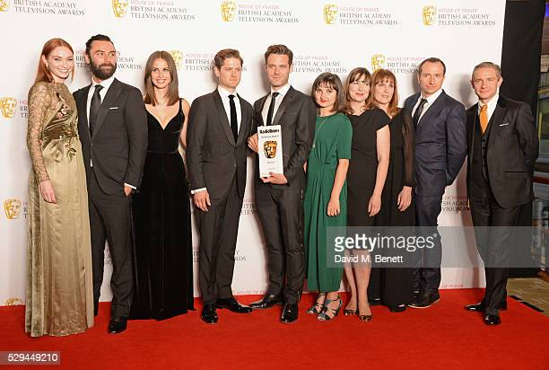 Presenter Martin Freeman poses with Eleanor Tomlinson Aidan Turner Heida Reed Kyle Soller Luke Norris Ruby Bentall and guests accepting the Radio...