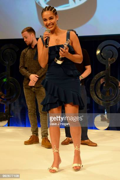 Presenter Maverick Sabre and Jorja Smith winner of the Amazon Music Best Newcomer Award on stage during the Nordoff Robbins' O2 Silver Clef Awards...