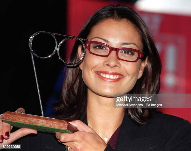 TV presenter Melanie Sykes holding the Female Spectacle Wearer of the Year award which she won today during a ceremony at the Fashion Cafe in...