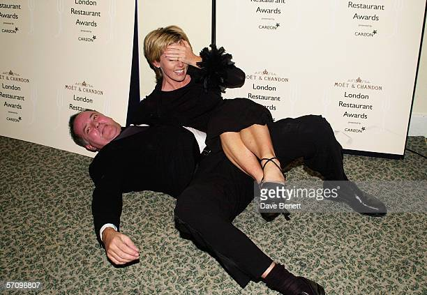 TV presenter Michael Barrymore and TV presenter Mary Nightingale fall over at the Moet Chandon Carlton TV London Restaurant Awards at the Grosvenor...