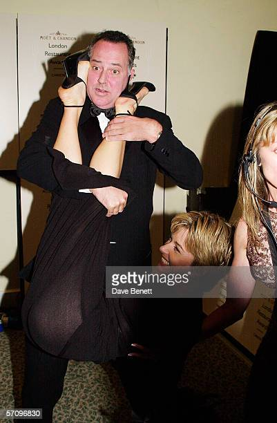 TV presenter Michael Barrymore drops TV presenter Mary Nightingale at the Moet Chandon Carlton TV London Restaurant Awards at the Grosvenor House...