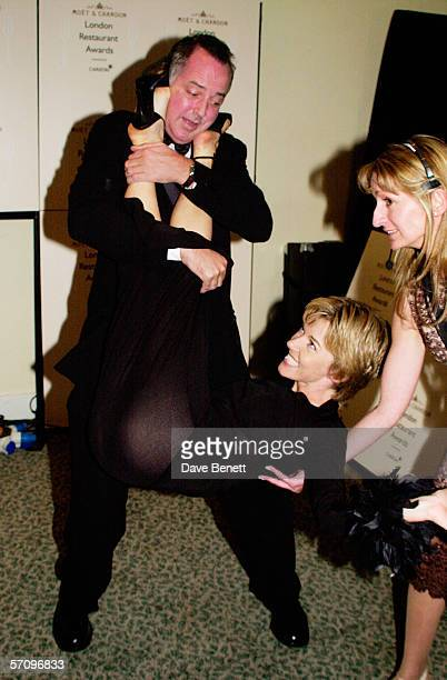 Presenter Michael Barrymore drops TV presenter Mary Nightingale at the Moet & Chandon Carlton TV London Restaurant Awards at the Grosvenor House...
