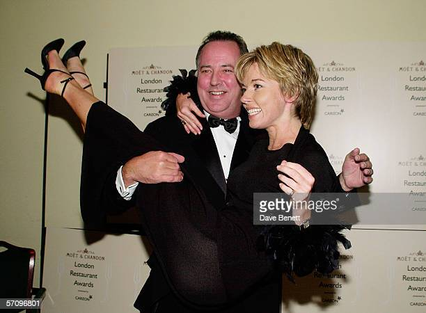 TV presenter Michael Barrymore lifts up TV presenter Mary Nightingale at the Moet Chandon Carlton TV London Restaurant Awards at the Grosvenor House...