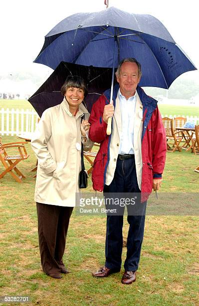 TV presenter Michael Buerk and guest attend the Cartier International Day at Guards Polo Club Windsor Great Park on July 24 2005 in Windsor England