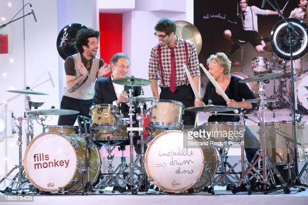 TV presenter Michel Drucker and main Guest of the show humorist Muriel Robin perform with The 'Fills Monkey' Yann Coste and Sebastien Rambaud at the...