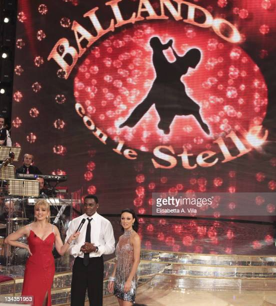 Presenter Milly Carlucci Carl Lewis and dancer Nancy Berti appear on the Italian TV show 'Ballando Con Le Stelle' at RAI Auditorium on January 9 2010...