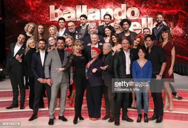 Presenter Milly Carlucci poses with members of the cast at the photocall for 'Ballando Con Le Stelle' at RAI Auditorium on March 8 2018 in Rome Italy