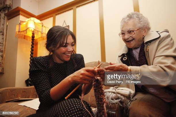 T4 presenter Miquita Oliver learns to knit with Lily Rams 88 from Willesden London in a lifesize recreation of a 1940s at the Imperial War Museum in...