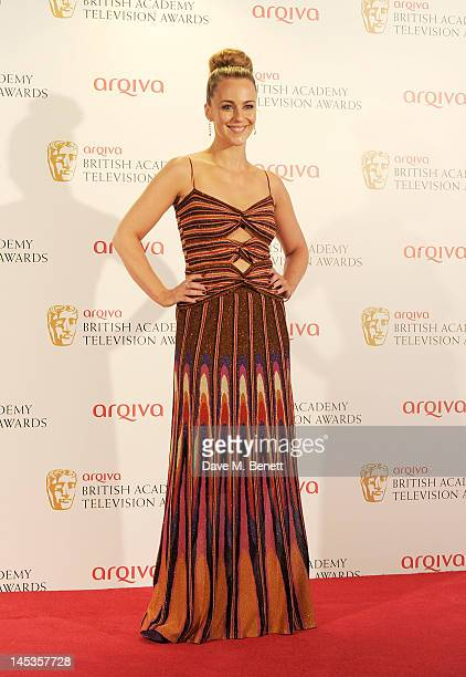 Presenter Miranda Raison poses in front of the winners boards at the Arqiva British Academy Television Awards 2012 held at Royal Festival Hall on May...