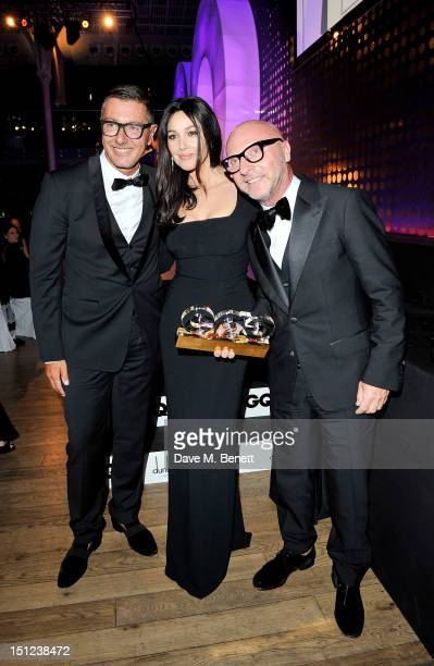 Presenter Monica Bellucci poses with Designer winners Stefano Gabbana and Domenico Dolce at the GQ Men Of The Year Awards 2012 at The Royal Opera...