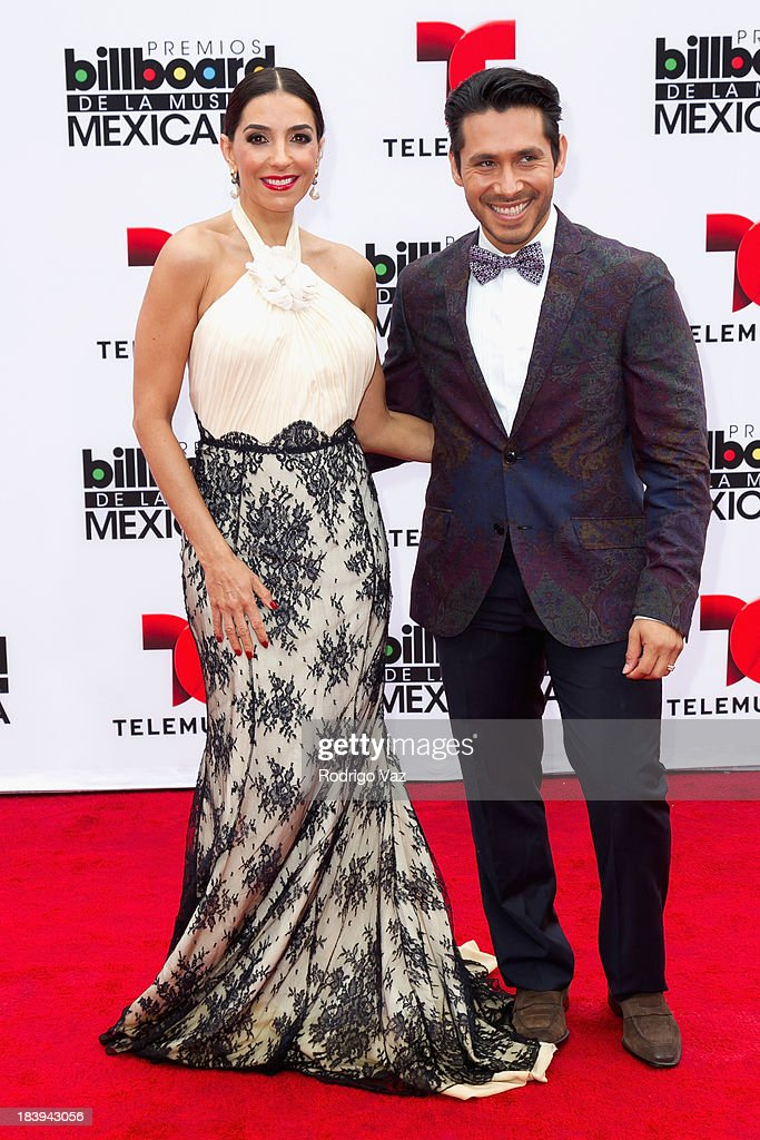 Presenter Monica Noguera (L) and TV personality Christian Ramirez attend the 2013 Billboard Mexican Music Awards arrivals at Dolby Theatre on October 9, 2013 in Hollywood, California.