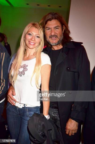 TV presenter Nadine Rodd and a guest attend the Escada Cocktail Event at Escada Store Montaigne on May 2 2011 in Paris France