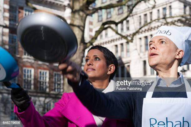 BBC presenter Naga Munchetty and Clive Lewis MP practice flipping their pancakes as they take part in the 20th Parliamentary Pancake Race on Shrove...