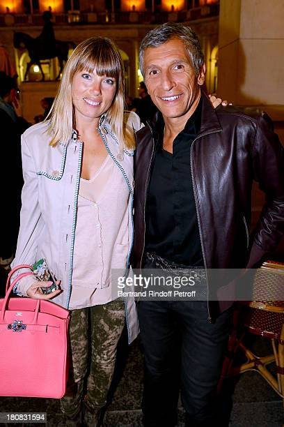 TV presenter Nagui and his wife actress Melanie Page attend 'Nina' Premiere at Theatre Edouard VII on September 16 2013 in Paris France