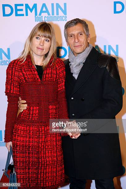 Presenter Nagui with his wife actress Melanie Page attend the 'Demain Tout Commence' Paris Premiere at Cinema Le Grand Rex on November 28 2016 in...