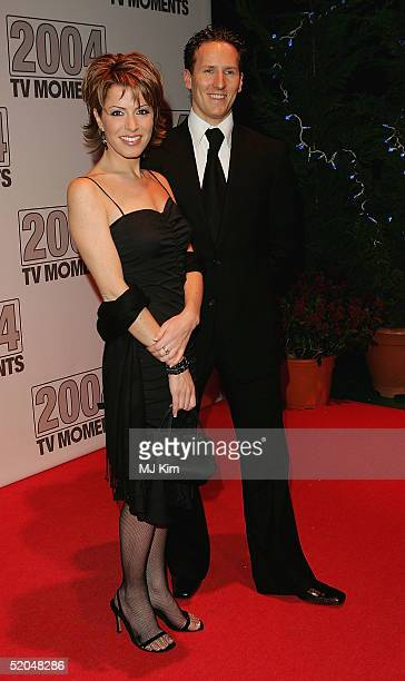 TV presenter Natasha Kaplinsky and Brendan Cole of Strictly Come Dancing arrive at the 2004 TV Moments Awards Ceremony at BBC Television Centre on...