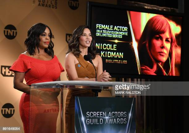 Presenter Niecy Nash and actress Olivia Munn announce the actress 'Nicole Kidman' during the 24th Annual Screen Actors Guild Awards Nominations...