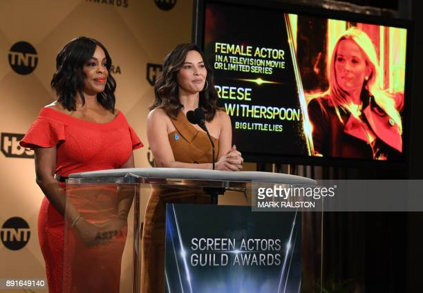 Presenter Niecy Nash and actress Olivia Munn announce the actress 'Reese Witherspoon' during the 24th Annual Screen Actors Guild Awards Nominations...