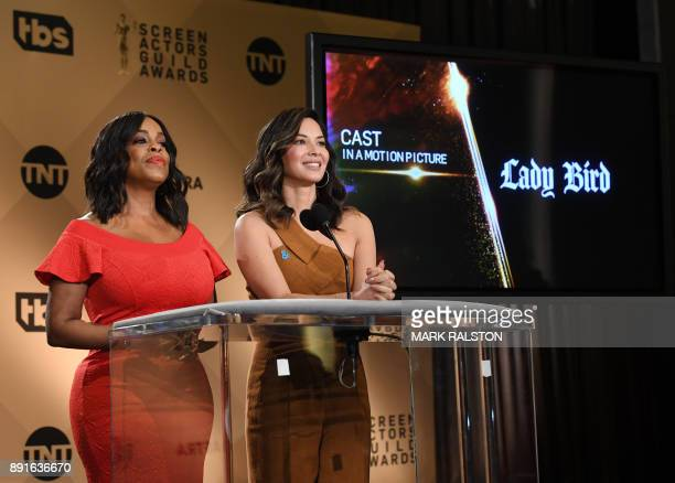 Presenter Niecy Nash and actress Olivia Munn announce the movie 'Lady Bird' during the 24th Annual Screen Actors Guild Awards Nominations...