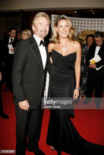 TV Presenter Noel Edmonds and actress Claire Sweeney arrive at the Pioneer British Academy Television Awards 2006 at the Grosvenor House Hotel on May...