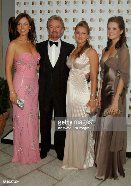 Presenter Noel Edmonds and his daughters Charlotte Lorna and Olivia arrive for the TV Baftas at the Grosvenor House Hotel in central London